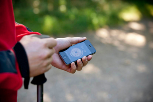 A man holding a smartphone with a compass application, close upの写真素材 [FYI02122521]