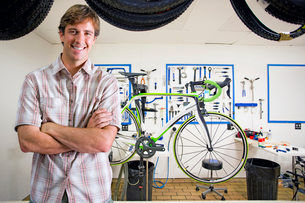 Store owner or customer in bicycle shop smiling at cameraの写真素材 [FYI02123180]