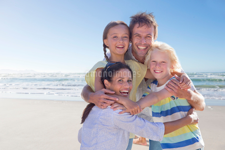 Portrait Of Family Having Fun On Beach Vacation Togetherの写真素材 [FYI02123362]