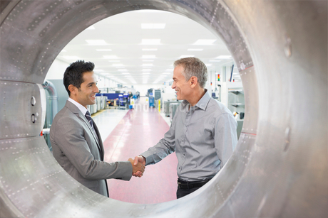 Two Businessmen Meeting In Engineering Factory In Factoryの写真素材 [FYI02123400]