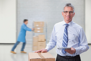 Portrait Of Businessman In Warehouse Dispatch Areaの写真素材 [FYI02123412]