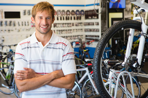 Store manager or customer in bicycle shop smiling at cameraの写真素材 [FYI02123484]