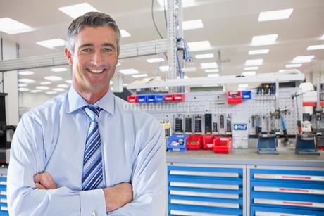 Portrait Of Businessman On Floor Of Engineering Factoryの写真素材 [FYI02123869]
