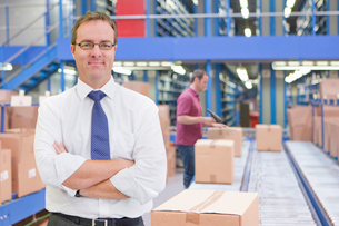 Portrait Of Businessman In Warehouse Dispatch Areaの写真素材 [FYI02124264]