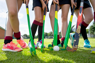 Legs of middle schoolgirls playing field hockey in physical education classの写真素材 [FYI02125462]