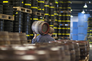 Brewer carrying a wooden beer keg at brewery in Traunstein, Bavaria, Germanyの写真素材 [FYI02127119]