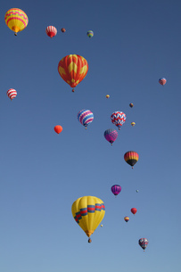 View of hot-air balloons against blue sky, Balloon Festival, Albuquerque, New Mexico, USAの写真素材 [FYI02127635]