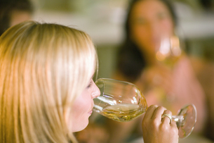 Close up of woman drinking wine indoorsの写真素材 [FYI02128080]