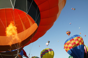 Low angle view of hot air balloons against blue sky, Balloon Festival, Albuquerque, New Mexico, USAの写真素材 [FYI02128313]