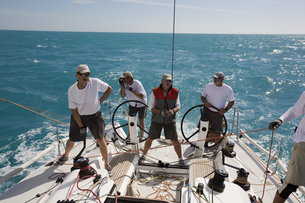 Group of men standing on sailboat in Key West, Florida, USAの写真素材 [FYI02128511]