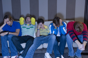 Group of frustrated men on sofaの写真素材 [FYI02128882]