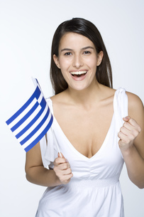 Young woman holding Greek flagの写真素材 [FYI02129167]