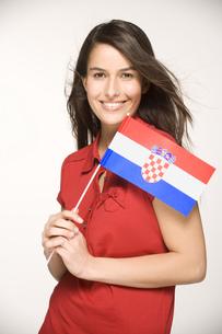 Young woman holding Croatian Flagの写真素材 [FYI02129252]