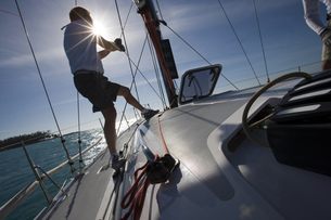 Rear view of mid adult man sailing in Key West, Florida, USAの写真素材 [FYI02129896]