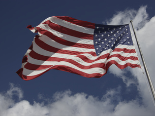 Low angle view of American flagの写真素材 [FYI02130079]