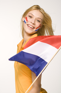 Young woman holding Dutch flagの写真素材 [FYI02130626]