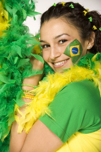 Hispanic woman with Brazilian flag painted on faceの写真素材 [FYI02131190]