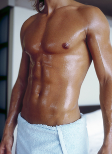 View of a young man's torso just out of the showerの写真素材 [FYI02131220]