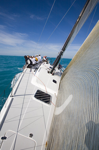 High angle view of group sitting on edge of sailboat in Key West, Florida, USAの写真素材 [FYI02131417]