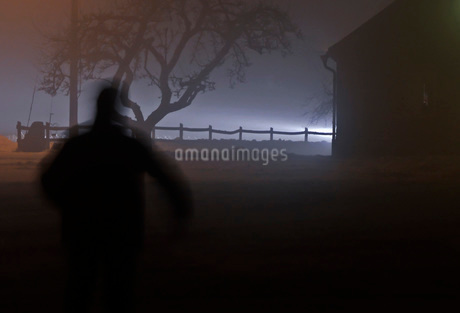 Person fleeing into the darknessの写真素材 [FYI02132013]