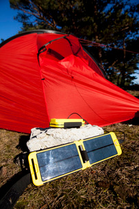 Solar charger in front of tent at camping siteの写真素材 [FYI02135940]