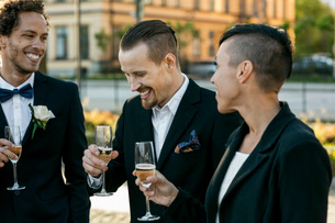 Happy friends with champagne during wedding ceremonyの写真素材 [FYI02140989]