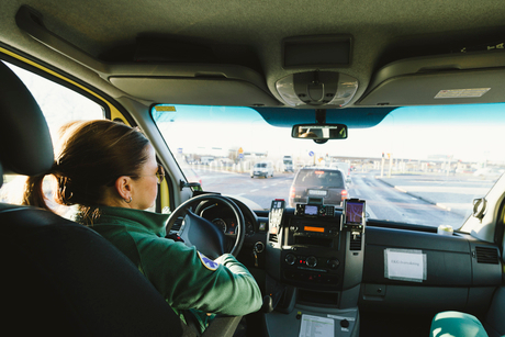 Rear view of female paramedic sitting on driver's seat in ambulanceの写真素材 [FYI02141069]