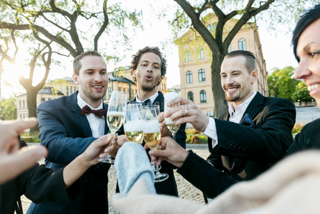 Happy friends toasting champagne during wedding ceremonyの写真素材 [FYI02143269]