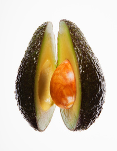 Close up of split avocadoの写真素材 [FYI02144924]