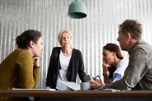 Businessman discussing with female colleagues in board room at creative officeの写真素材 [FYI02146834]