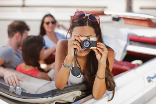 Woman taking picture from convertibleの写真素材 [FYI02147788]