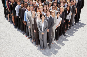 Portrait of business people forming triangleの写真素材 [FYI02147928]