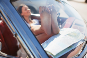 Close up of woman's dirty feet on dashboardの写真素材 [FYI02147984]