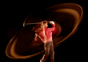 Time lapse view of golfer swingingの写真素材 [FYI02148880]