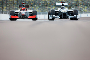 Race cars driving on trackの写真素材 [FYI02149566]