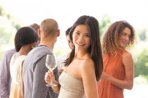 Woman having glass of wine at partyの写真素材 [FYI02150673]