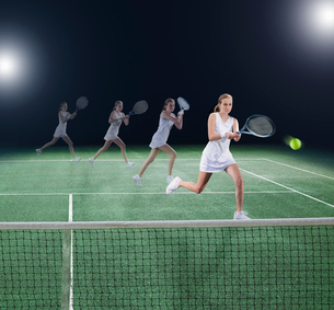 Multiple exposure of tennis player hitting ball on courtの写真素材 [FYI02150696]