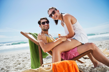 Portrait of smiling couple with sunscreen-covered noses at bの写真素材 [FYI02153041]