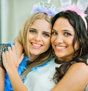 Portrait of smiling women wearing tiara and bunny earsの写真素材 [FYI02155145]