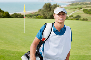 Caddy smiling on golf courseの写真素材 [FYI02155483]