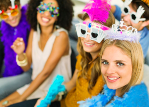 Friends wearing decorative glasses and crowns at partyの写真素材 [FYI02155694]