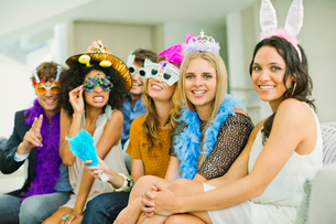 Friends wearing decorative glasses and headpieces at partyの写真素材 [FYI02155841]
