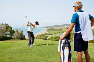 Men playing golf on courseの写真素材 [FYI02156095]