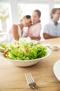 Close up of bowl of salad on tableの写真素材 [FYI02156275]