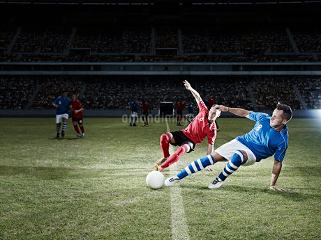 Soccer players kicking for ball on fieldの写真素材 [FYI02157495]