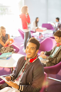 University student using digital tablet in loungeの写真素材 [FYI02157546]