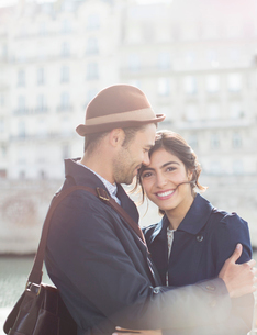 Couple hugging outdoorsの写真素材 [FYI02158516]