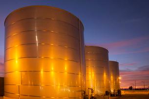 Silage storage tanks illuminated at nightの写真素材 [FYI02158712]