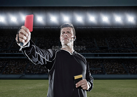 Referee flashing red card on soccer fieldの写真素材 [FYI02159252]
