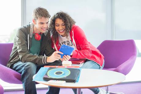 University students using digital tablet in loungeの写真素材 [FYI02159380]